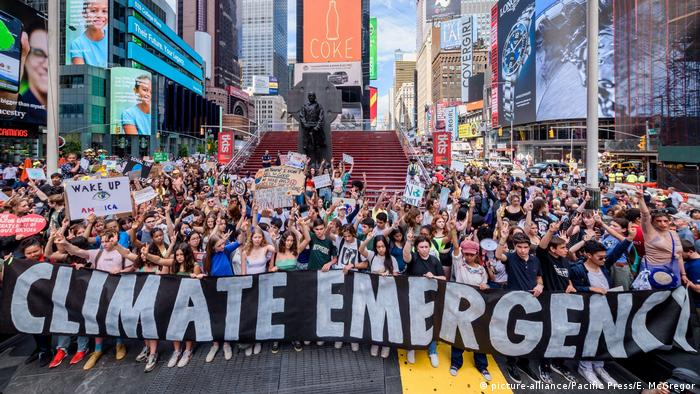 Hundreds of New York City students, young people and climate activists gathered at Columbus Circle for a rally followed by a march and die-in to Times Square