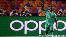 Senegal's forward Sadio Mane flashes the victory gesture as he reacts after scoring a goal during the 2019 Africa Cup of Nations (CAN) Round of 16 football match between Uganda and Senegal at the Cairo International Stadium in the Egyptian capital on July 5, 2019. (Photo by JAVIER SORIANO / AFP) (Photo credit should read JAVIER SORIANO/AFP/Getty Images)