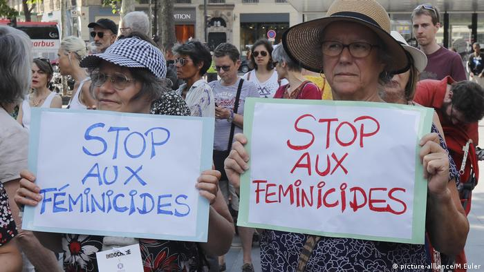 Protesters display placards demanding an end to femicide in France