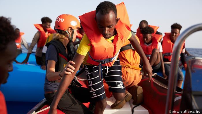 Crew aboard the Alan Kurdi rescue migrants at sea