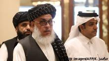 Taliban negotiator Abbas Stanikzai (L) arrives to attend the Intra Afghan Dialogue talks in the Qatari capital Doha on July 7, 2019. - Dozens of powerful Afghans met with a Taliban delegation on July 7, amid separate talks between the US and the insurgents seeking to end 18 years of war. The separate intra-Afghan talks are attended by around 60 delegates, including political figures, women and other Afghan stakeholders. The Taliban, who have steadfastly refused to negotiate with the government of President Ashraf Ghani, have stressed that those attending are only doing so in a personal capacity. (Photo by KARIM JAAFAR / AFP) (Photo credit should read KARIM JAAFAR/AFP/Getty Images)