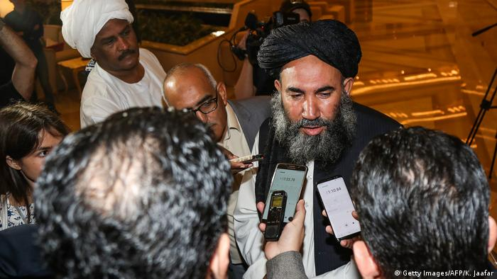 Mullah Abdul Salam Zaeef, a senior Taliban official, speaks to reporters during the intra-Afghan talks in Doha on July 7, 2019