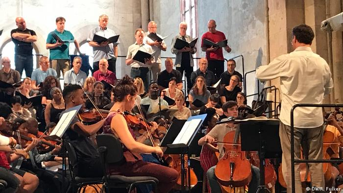 Musicians rehearse in an old church