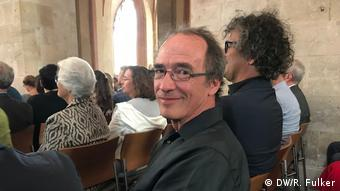 Peter Guy seated in the audience at the concert.