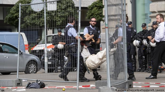 Police carry off climate protesters from the entrance of the Credit Suisse headquarters in Zurich, Switzerland