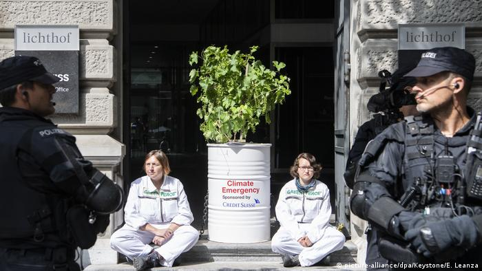 Protesters in front of a Credit Suisse branch