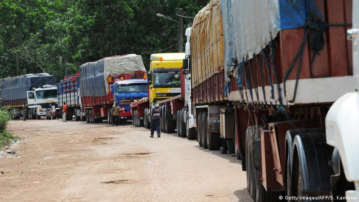 Freight trucks wait on the border between the Ivory Coast and Ghana
