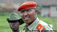 (FILES) A picture taken on January 11, 2009 shows the leader of the rebels and chief of staff of the National Congress for the Defence of the People (CNDP) General Ntaganda Bosco at his mountain base in Kabati, 40km north west of the provincial capital Goma. Dissident commanders from the main rebel group in eastern Democratic Republic of Congo declared on January 16, 2009 an end to the conflict in the troubled region. The renegade rebels led by Bosco Ntaganda also vowed to pave the way for displaced civilians to return to their homes and allow rebels to join the army. AFP PHOTO/ LIONEL HEALING (Photo credit should read LIONEL HEALING/AFP/Getty Images)
