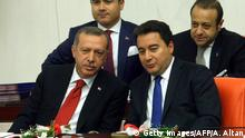 Turkey's Prime Minister Recep Tayyip Erdogan (L) and deputy Prime Minister Ali Babacan (2nd R) attend a debate as the Parliament reconvenes after a summer recess in Ankara October 1, 2013. In announcing a sweeping package of reforms ahead of elections next year, Turkey's Prime Minister Recep Tayyip Erdogan is vying to repair his image tarnished by the summer unrest, analysts say. The major political reforms including a reversal of a ban on Islamic headscarves, as well as broadened rights for Turkey's 15 million Kurds come on the heels of a wave of anti-government protests that rocked the country in the summer. AFP PHOTO / ADEM ALTAN (Photo credit should read ADEM ALTAN/AFP/Getty Images)