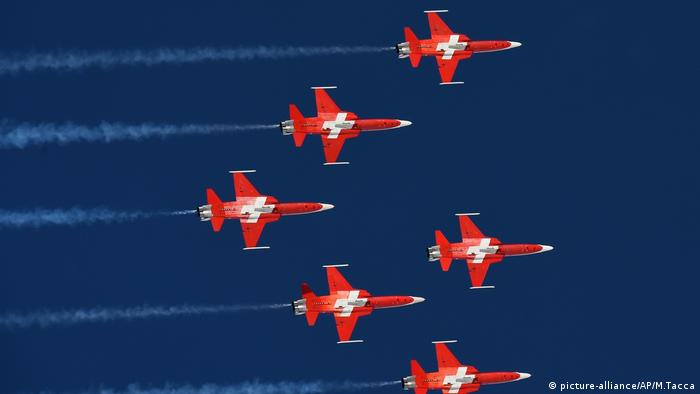 Red-and-white planes from the Patrouille Suisse aerobatic team