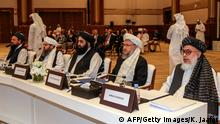 (L to R) The Taliban's former minister of agriculture Abdul Latif Mansoor, former envoy to Saudi Arabia Shahabuddin Delawar, former culture and information minister Amir Khan Mutaqi, former deputy education minister Abdul Salam Hanafi, and Taliban negotiator Abbas Stanikzai attend the Intra Afghan Dialogue talks in the Qatari capital Doha on July 7, 2019. - Dozens of powerful Afghans met with a Taliban delegation on July 7, amid separate talks between the US and the insurgents seeking to end 18 years of war. The separate intra-Afghan talks are attended by around 60 delegates, including political figures, women and other Afghan stakeholders. The Taliban, who have steadfastly refused to negotiate with the government of President Ashraf Ghani, have stressed that those attending are only doing so in a personal capacity. (Photo by KARIM JAAFAR / AFP) (Photo credit should read KARIM JAAFAR/AFP/Getty Images)