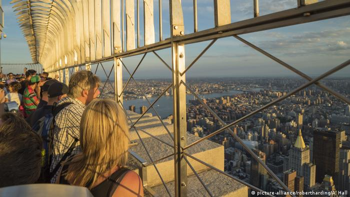 Visitors to the Observation Deck of the Empires State Building look out over the city of New York.