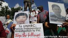Families of victims of alleged extra-judicial killings in the so-called war on drugs display portraits of their slain relatives following a mass at the Commission on Human Rights as they call for an investigation by the United Nations Human Rights Council Tuesday, July 9, 2019, in Manila, Philippines. The 47-member states of the UNHRC is set to vote on July 12 on a resolution proposed by Iceland and several other member countries to establish an independent investigation on the killings since Duterte came to power three years ago. (AP Photo/Bullit Marquez) |