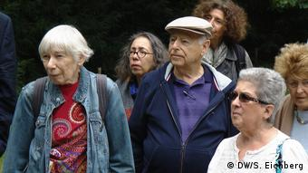 Ralph Mollerick, his wife Phyllis (right) and others commemorate the 80th anniversary of the Kindertransport in Berlin