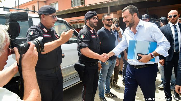 Italian Interior Minister Matteo Salvini greets police after closing the Mineo migrant center in Sicily