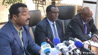 Members of the Sidama Liberation Movement seated in front of an array of microphones (DW/S. Wogayehu)