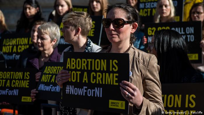 Abortion is not a crime posters held by protesters in London