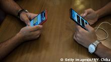 17.06.2019 Palestinian students use their phones to access the internet at a cafe, following a nation-wide mobile internet blackout, in the Sudanese capital Khartoum on June 17, 2019. - Internet on mobile phones and fixed land connections has been widely cut across Sudan since the violent dispersal of a protest camp outside army headquarters on June 3 that left dozens dead and hundreds wounded. The ruling military council imposed the blackout to prevent further mobilisation of protesters, according to users. (Photo by Yasuyoshi CHIBA / AFP) (Photo credit should read YASUYOSHI CHIBA/AFP/Getty Images)