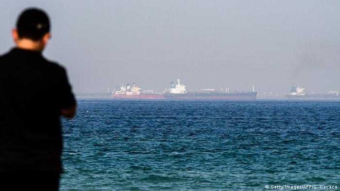 A man looks out at the Gulf of Oman