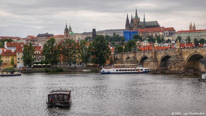Prague: Vltava River with Charles Bridge and Prague Castle in the background.
