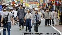 Elderly people walk street in Sugamo, a popular shopping district among the elderly in Tokyo, Sept. 21, 2015. The government announced that the number of people aged 80 or older in Japan topped 10 million for the first time. The number rose by 380,000 from a year before to 10.02 million, accounting for 7.9 pct of the country's total population. The number of people aged 65 or older grew to a record of 33.84 million, including 14.62 million men and 19.21 million women. |