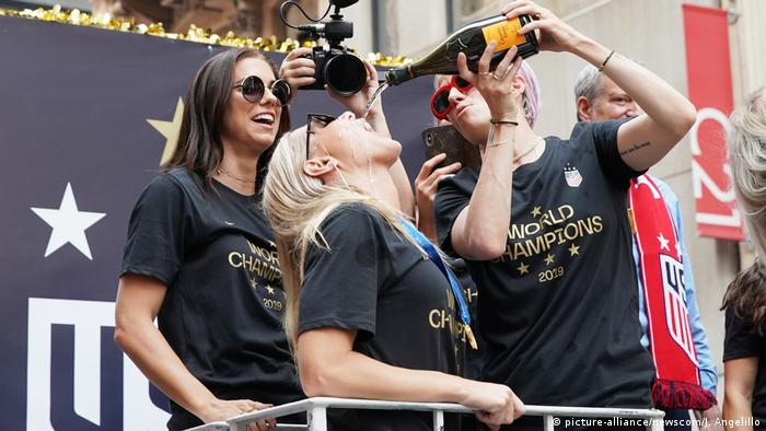USA women's football team players celebrate in New York