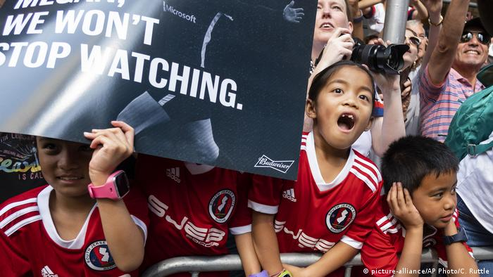 A girl looks in awe as she watches the US women's soccer team in New York