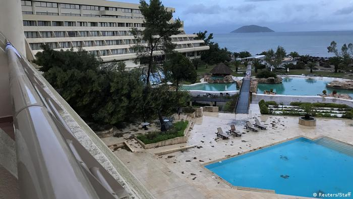 A damaged resort and pool