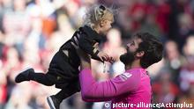12th May 2019, Anfield, Liverpool, England; EPL Premier League football, Liverpool versus Wolverhampton Wanderers; Liverpool goalkeeper Alisson Becker plays with his daughter during the post match lap of honour  