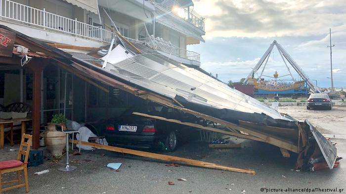 A car trapped under a collapsed roof