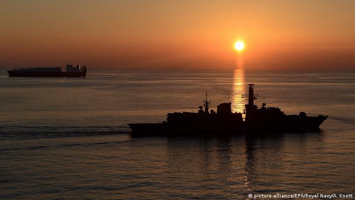 A handout photo released by the British Ministry of Defence (MoD) on 26 February 2014 shows the British type 23 (Duke class) frigate 'HMS Montrose' (F236) of the Royal Navy operating next to the Norwegian cargo vessel 'Taiko' (L) in the Mediterranean Sea near Cyprus