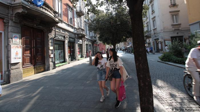 Chinese residents walking along the Via Paolo Sarpi, Milan