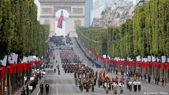 European troops joined French colleagues on the Champs Elysees