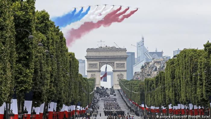 French jets fly over the Champs-Elysees avenue during the Bastille Day parade in Paris