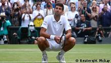 Tennis - Wimbledon - All England Lawn Tennis and Croquet Club, London, Britain - July 14, 2019 Serbia's Novak Djokovic celebrates winning the final against Switzerland's Roger Federer REUTERS/Hannah McKay