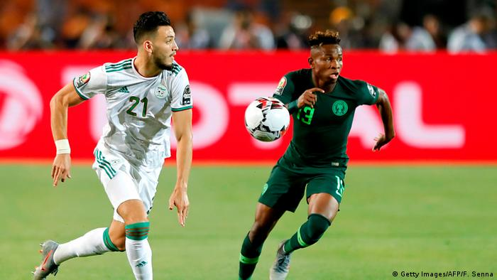 Algeria's defender Ramy Bensebaini (L) is marked by Nigeria's forward Samuel Chukwueze during the 2019 Africa Cup of Nations (CAN) Semi-final football match between Algeria and Nigeria at the Cairo International stadium in Cairo on July 14, 2019.