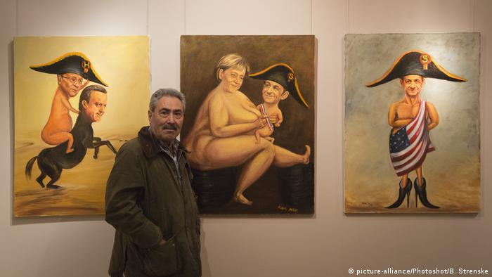 Kaya Mar exhition with satirical picture of Angela Merkel (picture-alliance/Photoshot/B. Strenske)