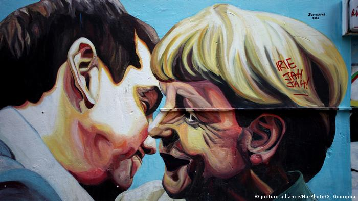 Alexis Tsipras and Angela Merkel in a graffiti picture in Athens (picture-alliance/NurPhoto/G. Georgiou)