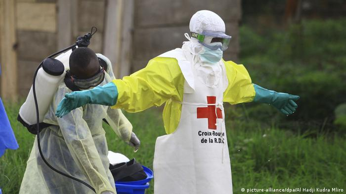 Two health workers in protective clothing