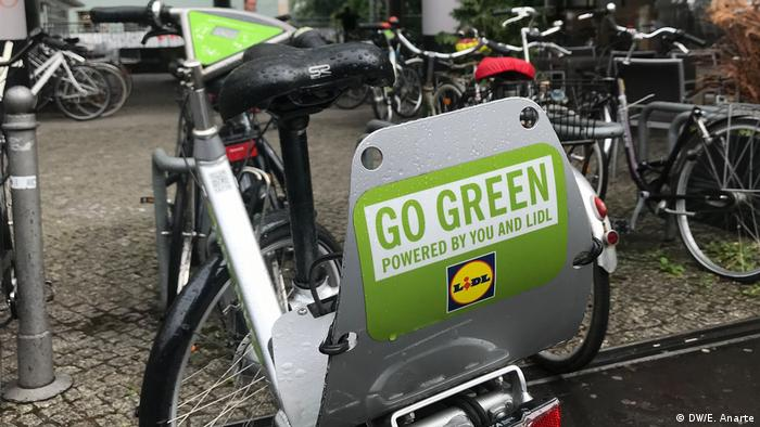 This bike urges people to Go Green sidewalk in the Prenzlauer Berg neighborhood of Berlin
