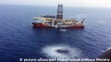 In this Tuesday, July 9, 2019 photo, a helicopter flies over Turkey's drilling ship, 'Fatih' dispatched towards the eastern Mediterranean, near Cyprus. Turkish officials say the drillships Fatih and Yavuz will drill for gas, which has prompted protests from Cyprus. (Turkish Defence Ministry via AP, Pool) |