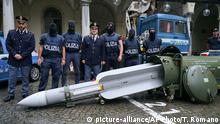 Police stand by a missile seized near Pavia, northern Italy