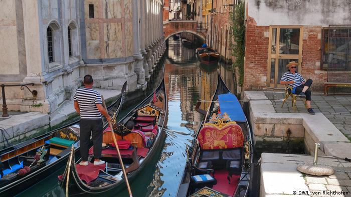 Gondoliers in Venice, Italy.