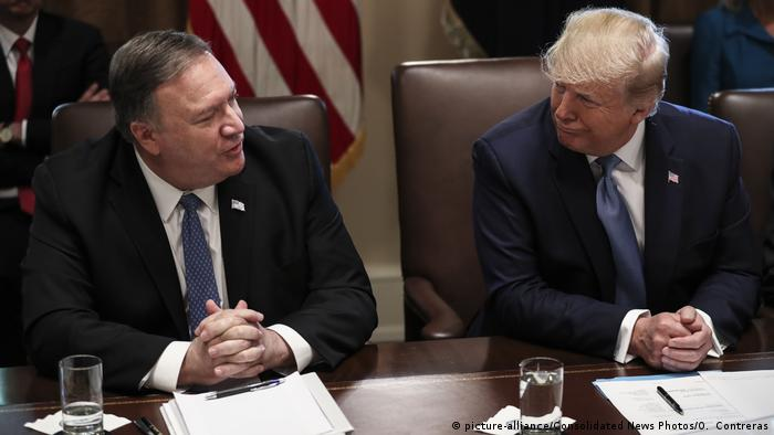 President Trump and Secretary Pompeo share a word