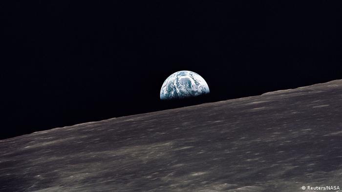 Earth rises above the lunar horizon (Reuters/NASA)