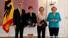 Outgoing German defence Minister Ursula von der Leyen, incoming German defence Minister Annegret Kramp-Karrenbauer, German Chancellor Angela Merkel and Berlin mayor Michael Mueller, deputising German President Frank-Walter Steinmeier, pose