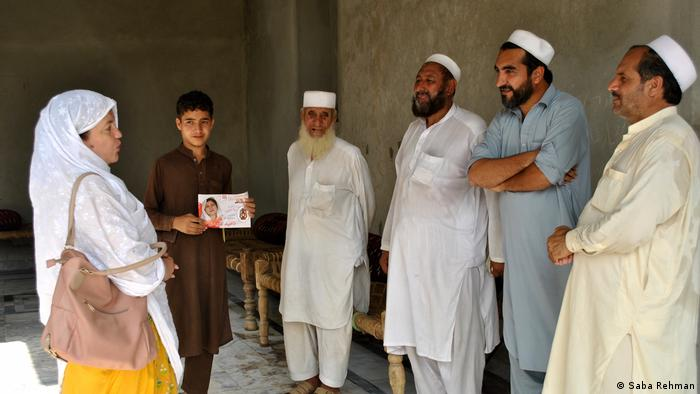 Naheed Afridi talks with tribal elders