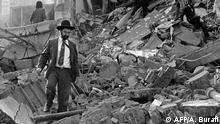 18.07.1994 (FILES) In this file photo taken on July 18, 1994, a man walks over the rubble left after a bomb exploded at the Argentinian Israeli Mutual Association (AMIA in Spanish) in Buenos Aires. - Twenty-five years passed of the explosion at the headquarters of the Jewish center AMIA, causing 85 deaths in the most serious attack in Argentine history that continues unpunished until today. (Photo by ALI BURAFI / AFP)