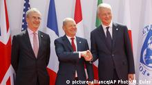 French Finance Minister Bruno Le Maire (R) welcomes German Finance Minister Olaf Scholz (C) with Governor of the Bank of France Francois Villeroy de Galhau, at the G7 meeting on July 17, 2019