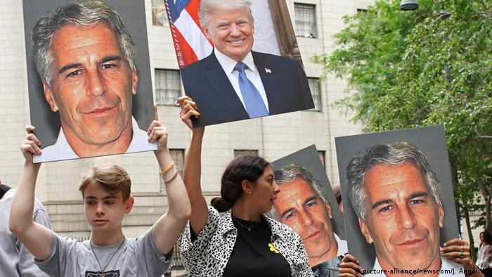 US protesters hold signs showing Trump and Epstein